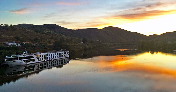 Emerald Radiance on the Douro River at sunset