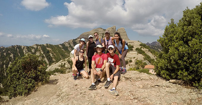 Tour group posing for a photo at montserrat