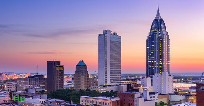 Mobile, Alabama, USA downtown skyline at sunset