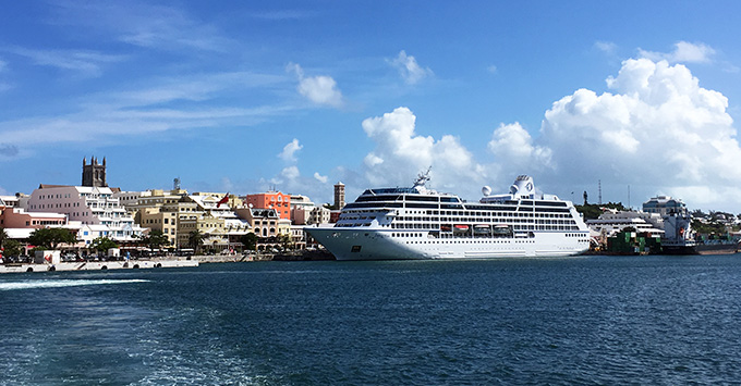 View of Insignia docked in sunny Bermuda from the viewpoint of a tender boat