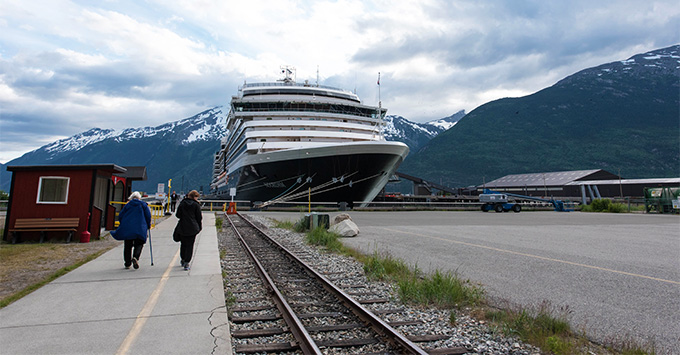 View of Noordam in Skagway, with mountainous Alaskan scenery in the background