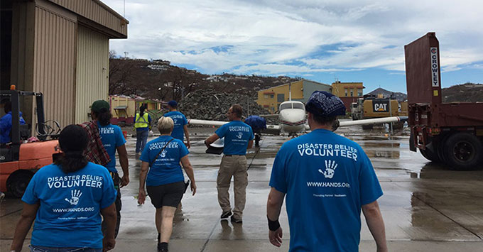View of volunteers in island damaged by hurricane