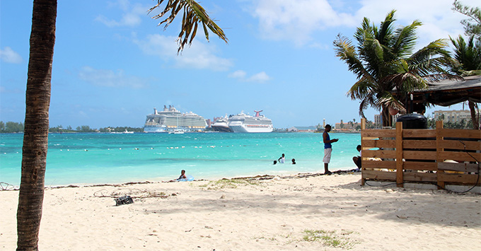 Cruise ships docked in a Caribbean port; view from Junkanoo Beach