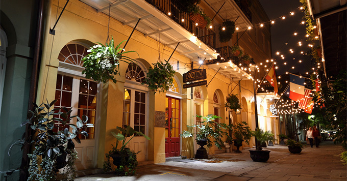 Night lights on a restaurant on Exchange Place in the French Quarter of New Orleans, Louisiana