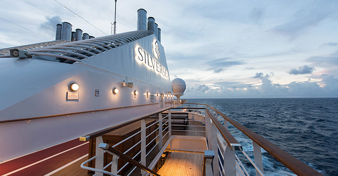 Exterior shot of Silver Muse funnel at sunset