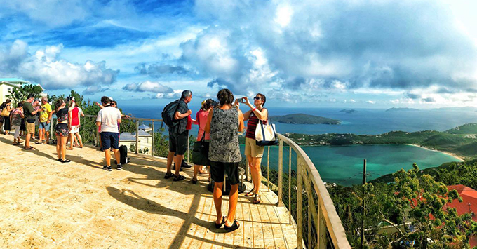 Tourists enjoying the view of Magen's Bay from the mountain top