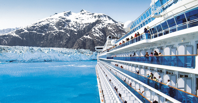 Side of cruise ship with glacier in the background