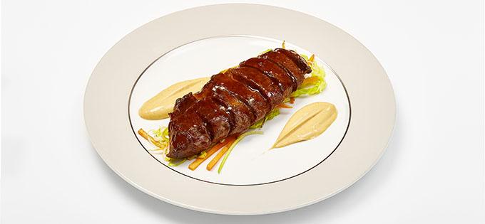Glazed Pluma of Iberico Pork with sauteed vegetables by Ramon Freixa for MSC Cruises