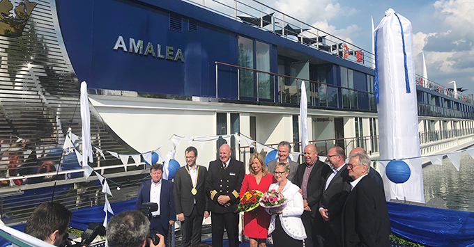 AmaWaterways team standing in front of ship during christening ceremony