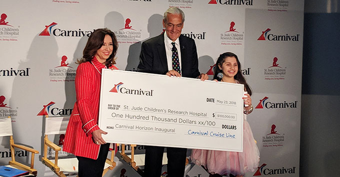 Richard Shadyac Jr., CEO and President of ALSAC, along side Victoria, accepting a $100,000 donation to St. Jude Children Research Hospital from Carnival Cruise Line, presented by Christine Duffy