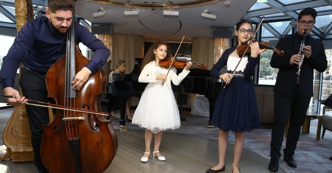 Young musicians of Virtuosos performing at Crystal Ravel's christening in Budapest