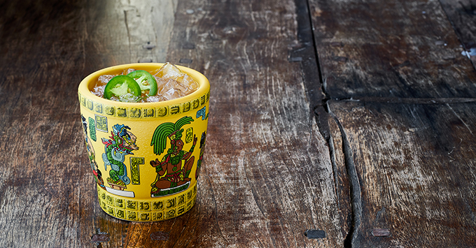 Cocktail in yellow Aztec cup