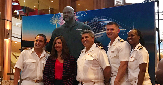 NBA Hall of Famer Shaquille 'Shaq' O'Neal and Christine Duffy, President of Carnival Cruise Line stand with Carnival Horizon Captain and Crew