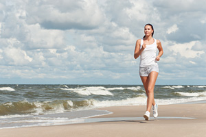 running-woman-beach-Royal-Caribbean