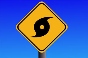road sign with hurricane symbol