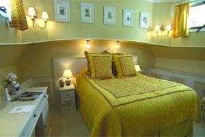Belmond Alouette - Cabins feature warm decor and plenty of natural light.