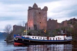 Scottish Highlander - Moored under Urquhart Castle