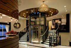 AmaSonata - Glass elevator lobby