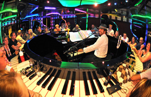 Carnival Splendor - Join a sing-along in the piano bar
